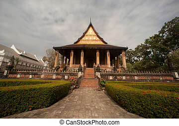 Ancient Laos art wood carving on church in Hor Phakeo temple...