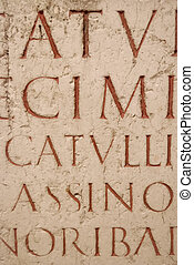 Ancient latin script carved into marble. Ruins at Lyon, ...