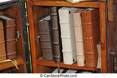 ancient leather-bound books in a antique shop