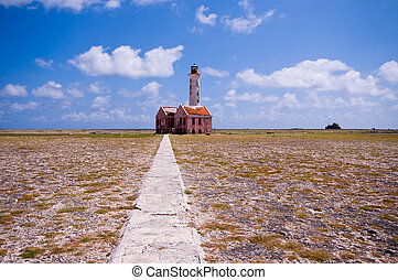ancient lighthouse ruin on little curacao with foot path