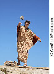 Ancient man throwing stone - Depiction of ancient man...