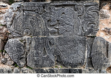 Ancient Mayan carvings at the Great Ball Court in Chichen Itza