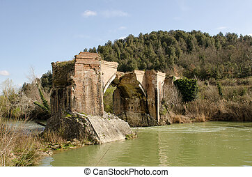 Ancient Medieval Bridge over a Creek in the Tuscany Countryside