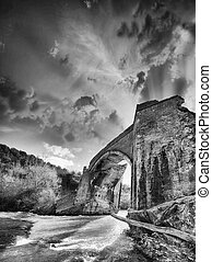 Ancient Medieval Bridge over a creek in Tuscany