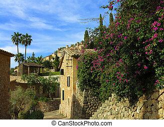 ancient mediterranean village - blooming bougainvillea in...