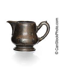 Ancient Milk Jug - Ancient bronze milk jug isolated on white...