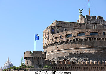 Monument called Castel Sant'Angelo in Rome and the European flag flying in the background you can see the dome of St. Peter