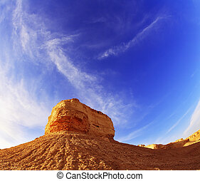Ancient mountains in desert of Israel on a sunset