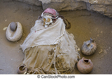 Mummy in foetal position at Chauchilla, a two thousand year ancient cemetery in the desert of Nazca, Peru.