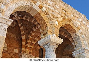 Ancient ornate arab arches in Brindisi, Puglia, Italy