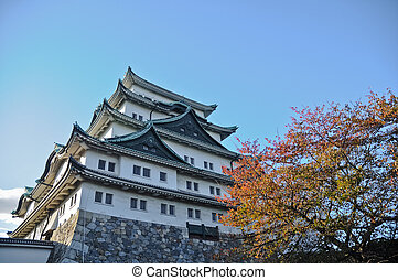 Ancient Osaka castle and maple trees in Autumn Kansai Japan