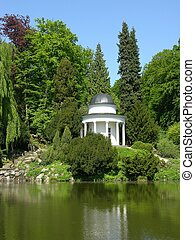 Ancient pavilion in a magnificent park scenery