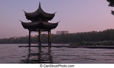 Ancient pavilion Jixian at West Lake before sunrise, Hangzhou, China. All Chinese words only introduce itself which means Jixian Pavilion without advertisement.