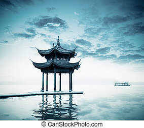 ancient pavilion on the west lake in hangzhou, China.