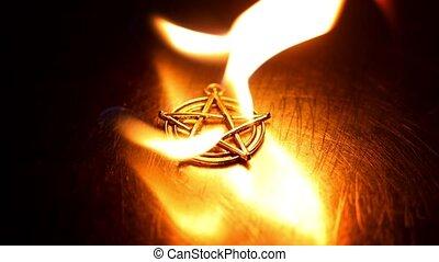 Ancient pentagram burning against steel plate