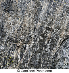 Ancient Primitive Petroglyphs on Black Rock Stone