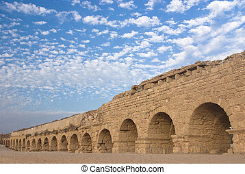 Ancient roman aquaduct at the ruined city of Cesaria -...
