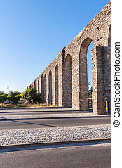 Ancient Roman aqueduct in Evora in afternoon sun, Portugal