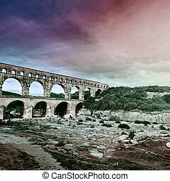 Aqueduct - Ancient Roman Aqueduct Pont du Gard at Sunset, ...