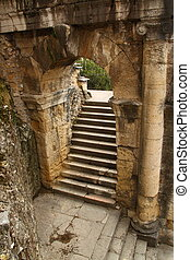 Ancient roman arch and staircase - An ancient arch above a ...