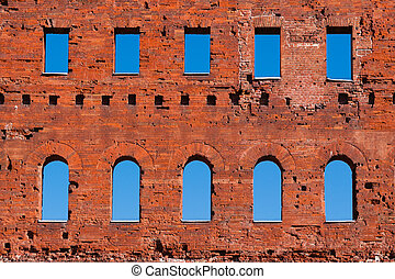 Ancient roman brick wall with blue sky.
