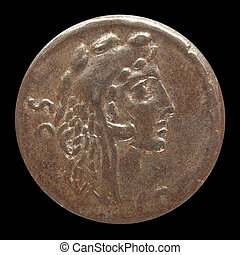 Ancient Roman coin isolated over black background