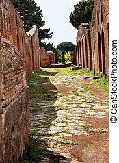 Ancient Roman Road Ruins Ostia Antica Ruins Rome Italy Excavation of Ostia, ancient Roman port, next to airport. Was port for Rome until 5th Century AD.