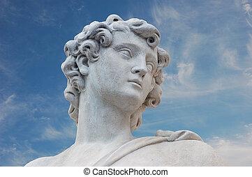 Ancient Roman Statue - Ancient roman statue against blue sky