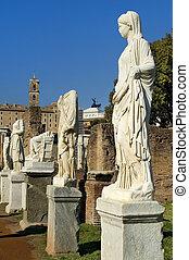 Ancient Roman statues on pedestals
