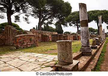 Ancient Roman Street Columns Ostia Antica Ruins Rome Italy Excavation of Ostia, ancient Roman port, next to airport. Was port for Rome until 5th Century AD.