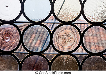 ancient round shaped glass in window - ancient castle window...