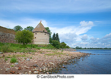 Ancient Royal tower on the bank of Neva river in the sunny summer day. Fortress Oreshek. Leningrad region, Russia