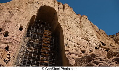 Ancient ruin archway niche with scaffolding.