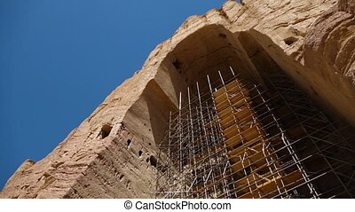 Ancient ruin archway with scaffolding.