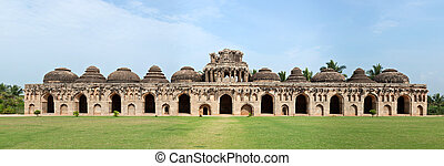 Ancient ruins of Elephant Stables, Royal Centre. Hampi, ...
