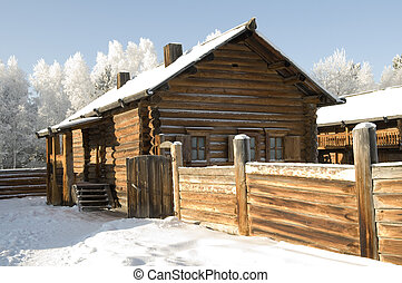 Ancient Russian log hut in the winter