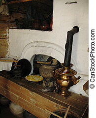 Ancient russian stove and  kitchen utensils