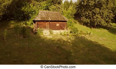 Ancient rustic cabin in a forest. House made of wooden logs.