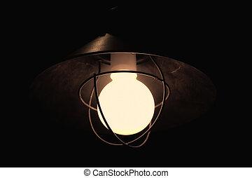 Ancient rusty street lantern in the dark