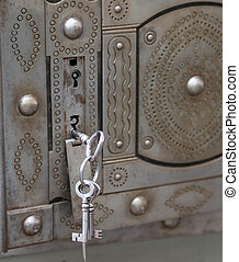 ancient safe with double lock and iron keys
