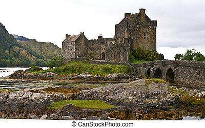 ancient scottish castle - eilean donan castle on a cloudy...