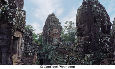 Ancient, Sculpted Stone Faces of Bayon Temple Ruin in...