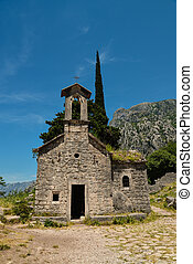 Ancient Serbian church ruins and mountain valley landscape ...