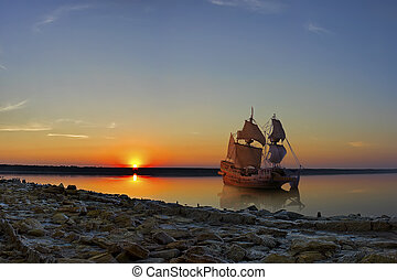 ancient ship - The ancient ship in the orange light of the...