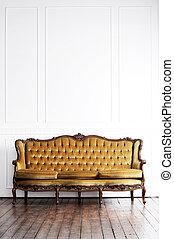 Ancient sofa in a retro interior