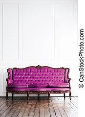 Ancient sofa in a retro interior. Vintage background