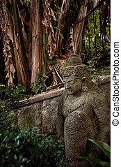 Ancient statue in the forest