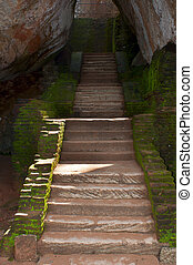 Ancient steps in rock fortress and palace on high Lion's...