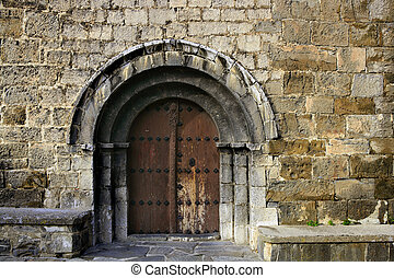 Ancient stone arch romanic architecture church in Spain ...