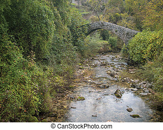 Ancient stone bridge just outside Equi Terme, Lunigiana, medieval spa village in Tuscany, Italy famous for its sulphur, sulfur spring water. In the Apuan Alps.